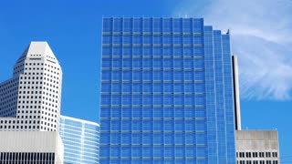 looking up at some highrise office buildings with sun flare 4k stock