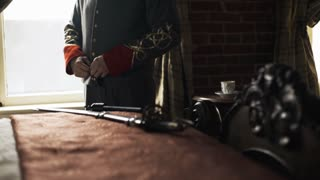 confederate captain buttons his coat and checks his weapons 4k