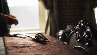 Confederate captain pacing in front of a window focus on hilt of saber 4k