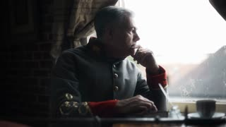 confederate captain sitting at a window thinking and pondering 4k