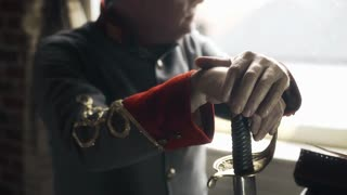 confederate captain sitting next to a window hands on saber 4k