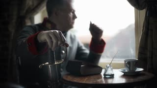 confederate captain sitting next to a window thinking focus on saber 4k