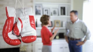 couple fighting with boxing gloves in the forground