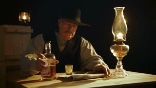 cowboy pouring whiskey