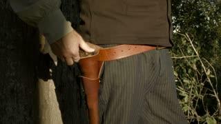 cowboy pulls his pistol.