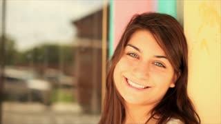 cute green eyed girl smiles at camera