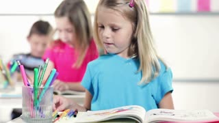 Cute kindergarten girl smiles at camara