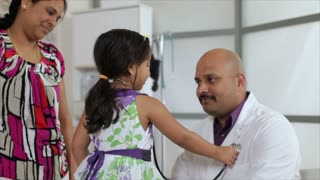 Cute little girl checking the doctor