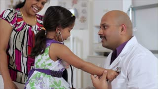 Cute little girl checking the doctor's heart