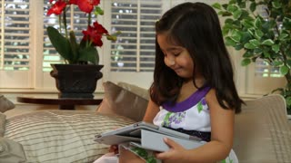 Cute little girl using a tablet pc