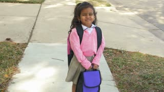 cute little Indian girl happy about going to school slow motion
