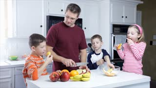 dad and kids eating fruit