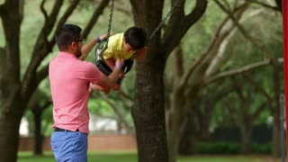dad playing with his son in the park.