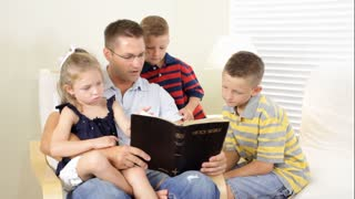 dad reading bible to kids