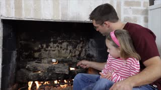 Dad Roasting Marshmallows with His Daughter