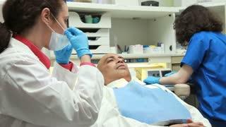 dental assistant hands dentist hand mirror.