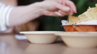 dipping chip in salsa