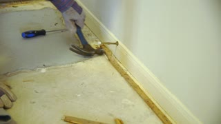 DIY demolition project of carpet tack strips by homeowner