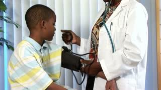 doctor and child blood pressure tilt