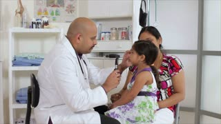Doctor checking a little girls eyes