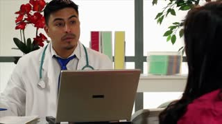 doctor handing paper to paitent