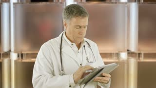 Doctor looking at a tablet pc
