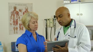 doctor showing patient something on a tablet pc.