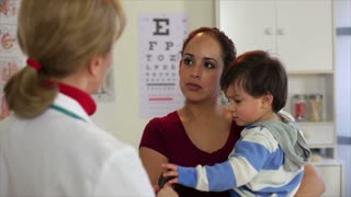 Doctor talking to a Hispanic mother