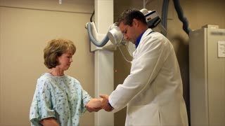 doctor with patient at the x-ray machine
