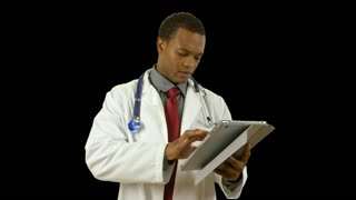 doctor with tablet pc smiles at camera with alpha.