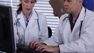 doctors typing and nurse
