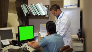 Doctors Working Stop and Smile at Camera