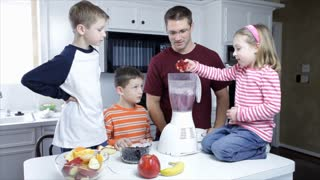 dolly left dad and kids making a smoothie