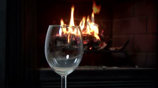 dolly pouring wine fireplace