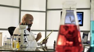 dolly scientist in lab thinking about the notes he is reading 4k