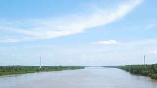 driving across a bridge overlooking a river in south louisiana 4k