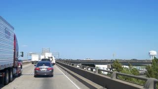Driving into congested slow merging traffic leading to the Mississippi river bridge in Baton Rouge Louisiana. Editorial