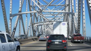Driving in heavy traffic on the Mississippi bridge in Baton Rouge Louisiana 4K. Editorial.