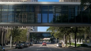 driving under overhead walkways in downtown houston