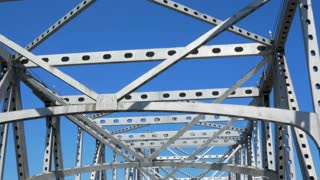 Driving under steel canopy of cantilever bridge which crosses over Mississippi River in Baton Rouge Louisiana.