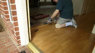 DYI project of removing old laminate flooring