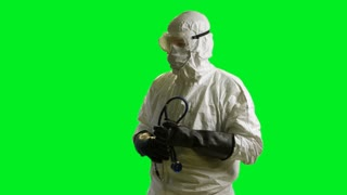 Ebola doctor in a hazmat suit looks at camera green screen