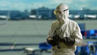 Ebola doctor in  front of an airport scene.