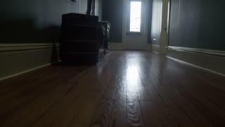 establishing walking shot through an old hallway to a door 4k