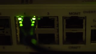 ethernet switch traffic light blinking in a dimly lit server room 4k