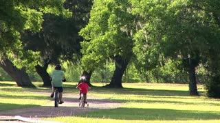 father son bike riding