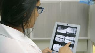 female dentist going over xray.