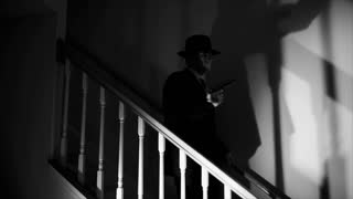 film noir gunman walking downstairs