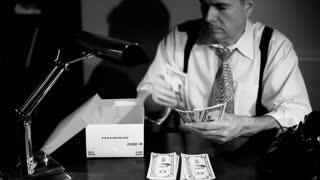 film noir man putting money in a shoe box