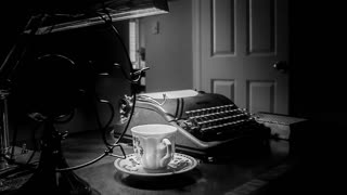 film noir shot of old fan and typewriter.